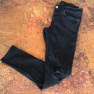 {H&M} Black Mid-Rise Distressed Skinny Jeans.